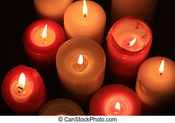burning candles - A group of burning candles in different...