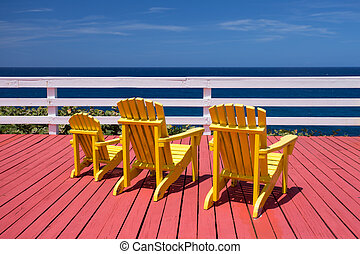 Adirondack Chairs - Three adirondack chairs on a red deck...
