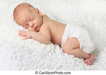 Newborn baby boy - Sleeping Newborn baby boy wearing a...