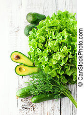 Mix of green vegetables - Fresh green vegetables on white...