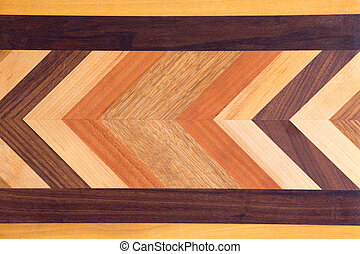 Decorative marquetry on a cutting board with inlaid wood of...