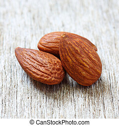 Close up of almonds on wood
