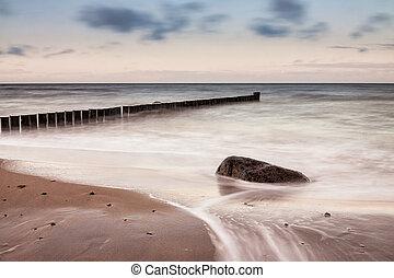 Groynes on shore of the Baltic Sea.