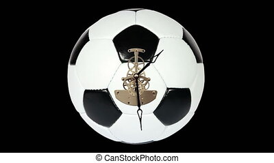 Soccer Ball Clock on the black background, Timelapse