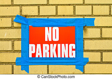 No parking sign taped to the wall