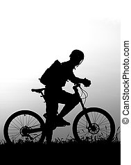 adventure cycling in the nature - mountain biker silhouette...