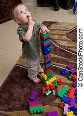 Boy with blocks - young toddler boy playing with large...