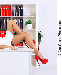 Beautiful Legs - legs of sexy businesswoman lying on table...