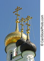 Domes of Iverskaya church in Orel, Russia vertical closeup