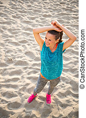 Happy fitness young woman on beach