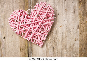 Pink heart on a rustic wooden background