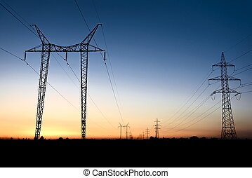 Large transmission towers at blue hour with horizon