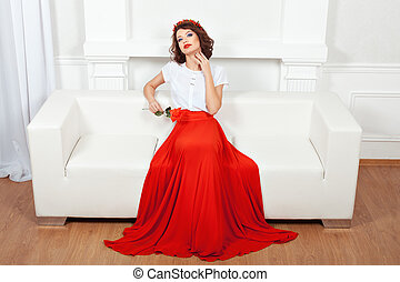 Brunette flirting - Brunette in red dress sitting on a white...