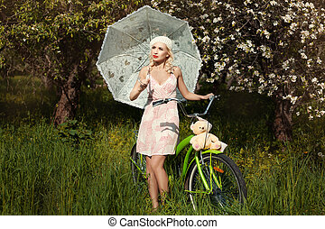 Girl with an umbrella from sun in the park.