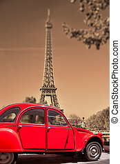 Eiffel Tower with old red car in Paris, France