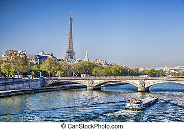 Eiffel Tower with boat on Seine in Paris, France - Famous...