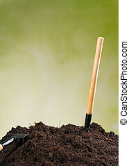 Pile of soil with green background - Pile of soil with...