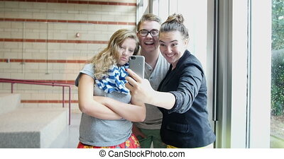 Students taking selfie pictures