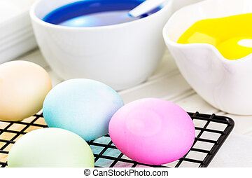 Easter eggs - Painting eggs in pastel colors for Easter.