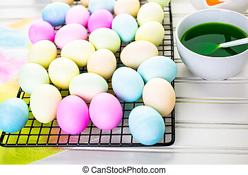 Easter eggs - Painting eggs in pastel colors for Easter