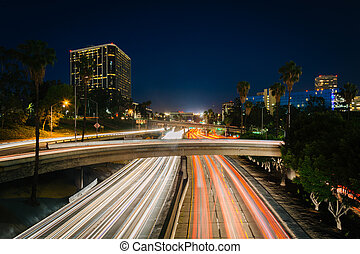 Traffic on the 110 Freeway and buildings in Los Angeles at night