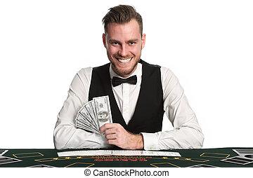 Smiling black jack dealer - Mature casino worker wearing a...