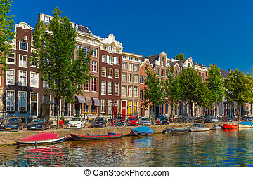 Amsterdam canals and typical houses, Holland, Netherlands -...