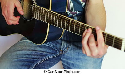 Man playing acoustic guitar.