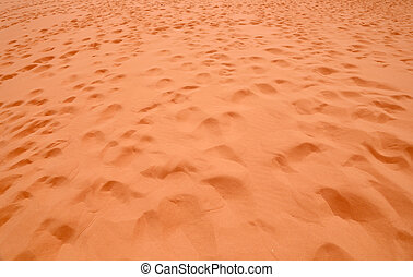 Red sand in a desert of Wadi Rum also known as The Valley of...