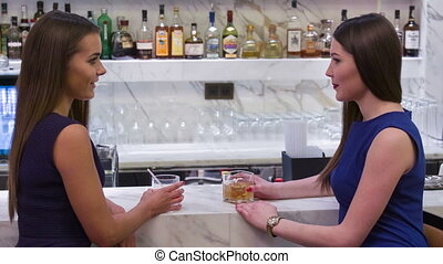 Two friends are talking at bar counter - What grounds for...