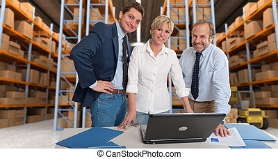 Logistics team a - Business team with a storage warehouse at...