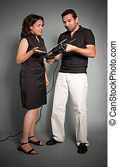 Couple with hand drill - Couple looking perplexed to a hand...