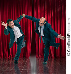 Business show - Funny stressed businessmen in a theater...
