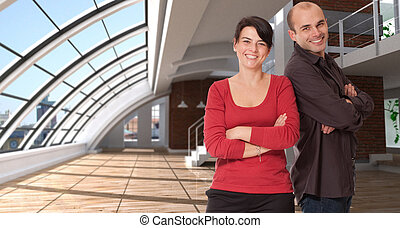 Business team in a loft - Smiling man and woman in a...