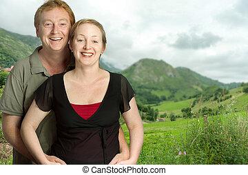 Happy couple in green fields - Portrait of a happy couple...