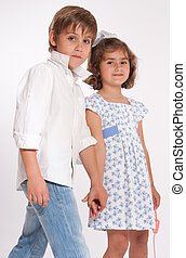 Little couple holding hands - A young boy and a little girl...