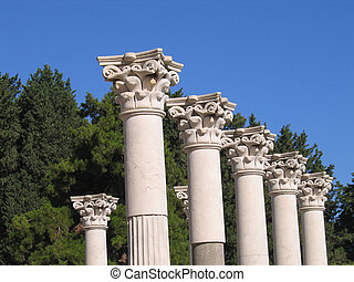 ancient columns of Greek temple in summer day