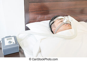 CPAP machine - Man with sleep apnea and CPAP machine