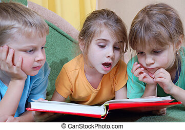 kids reading the same book - group of 5 year old kids...