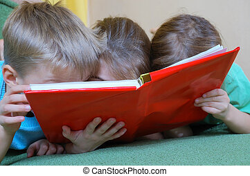 children reading a book - three 5 year old kid reading the...
