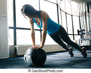 Cute young woman working out with fit ball - Cute attractive...
