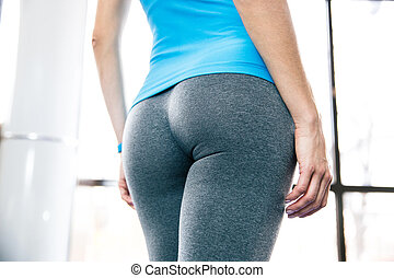 Back view portrait of female body at gym