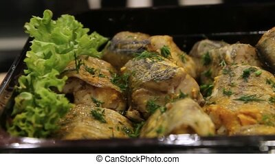 Heap of fried Fish with dill and lettuce on oven-tray - Heap...