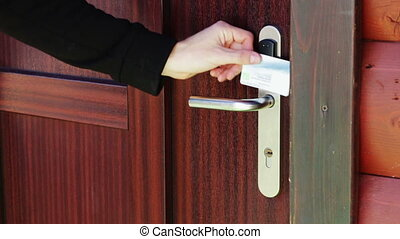 The man opens the door to an electronic key - card - Man...
