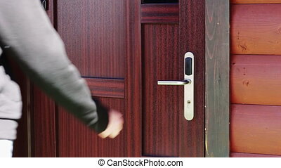 The man opens the door to an electronic key - card. - Man...