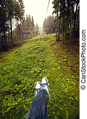 Legs in white shoes at Carpathian mountains