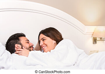 Cute Couple in bathrobe showing affection.