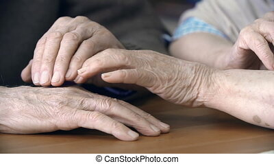Love to the End - Close up of four hands stroking each other