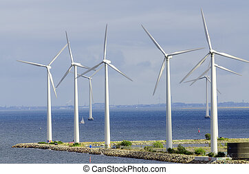 ind turbine generating electricity on sea - white wind...
