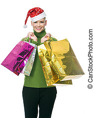 woman with bags - blonde smiling woman with christmas hat...